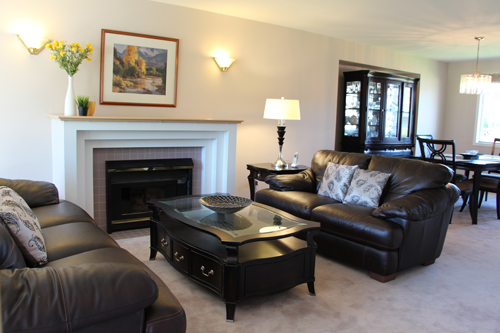 With personal and religious items removed the living room has more broad buyer appeal!