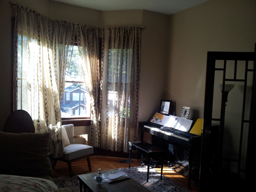 Modern sheers not working in this traditional formal living room, piano stuck in the corner...