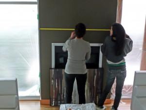 Lois & Yoshi Measuring to Hang Art