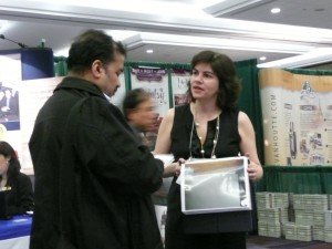 Sally talking to attendee