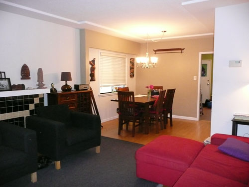 Chairs blocking fireplace; bland dining room