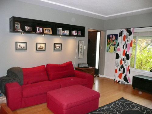 Family photos where they should be; new curtains add some fun to this family/living room!